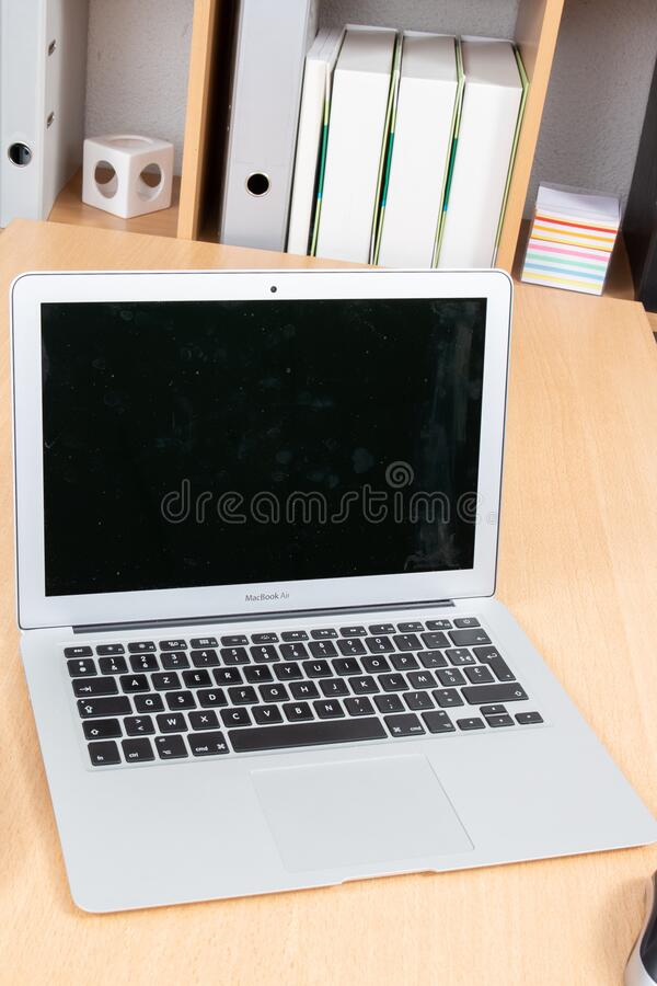 Bordeaux , Aquitaine / France - 03 30 2020 : Apple MacBook Air Silver on wood desk office home background in top view. Bordeaux ,  Aquitaine / France - 03 30 stock photo