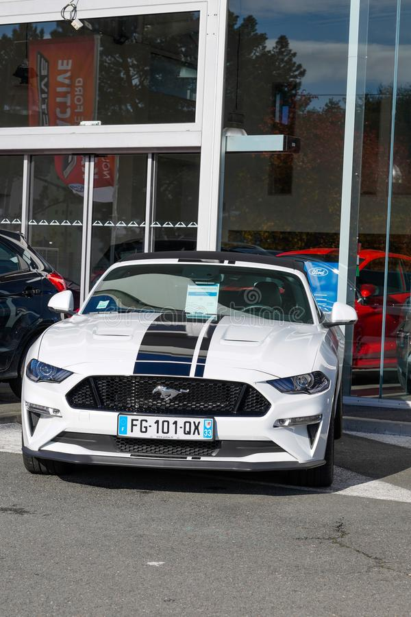 Bordeaux , Aquitaine / France - 11 13 2019 : Ford Mustang convertible car in front of automobile motor company dealership building stock photography