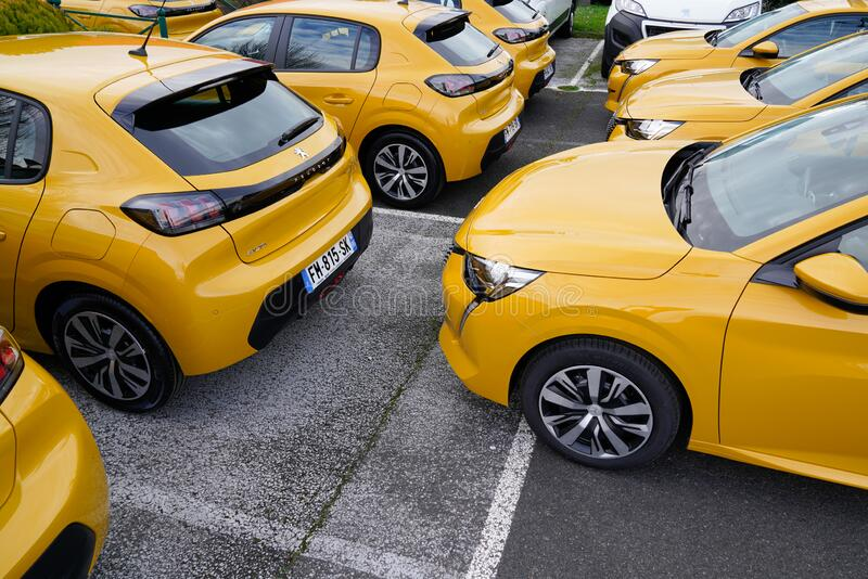 Bordeaux , Aquitaine / France - 01 15 2020 : several New Peugeot 208 gold yellow automobiles supermini car produced by the French stock image
