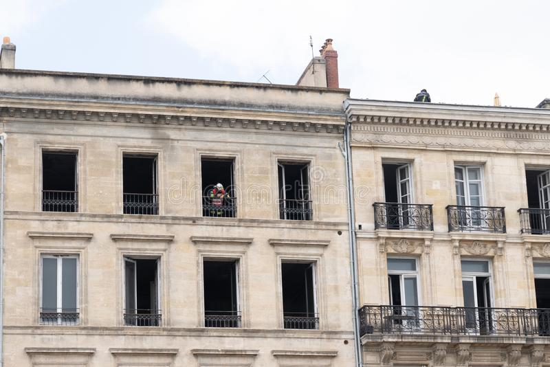 Bordeaux, Gironde / France - 05 26 2019 : building fire in building in Bordeaux city with firefighter man stock image