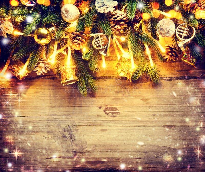 Border art design with decorated Christmas tree. Border art design with Christmas tree, baubles and light garland stock photos