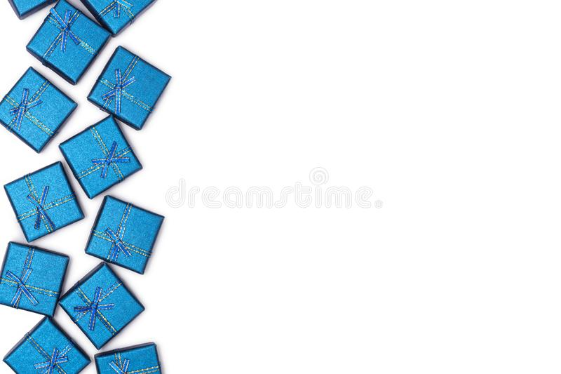 Border of blue shiny gifts isolated on white background. New Year`s decorations stock photography