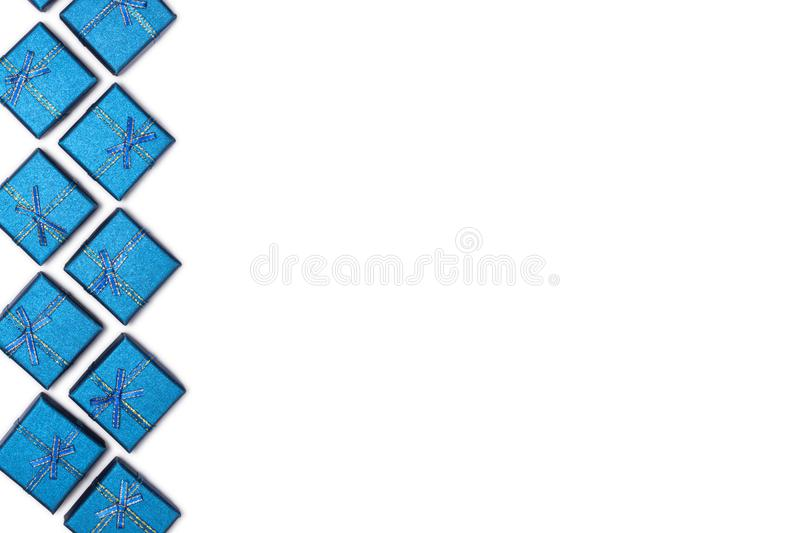 Border of blue shiny gifts isolated on white background. New Year`s decorations royalty free stock photo
