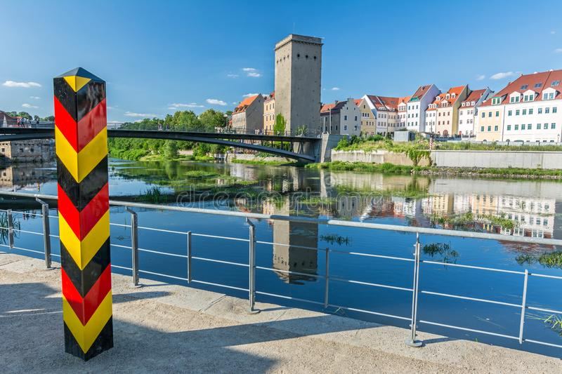 Border bollard at the German border to Poland near the Neisse river in Görlitz royalty free stock photography