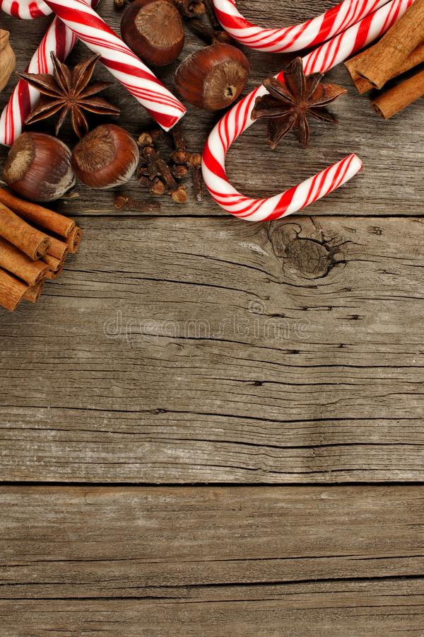 Border of Christmas baking goods and candies against rustic wood. Top border of Christmas baking goods and candies against a rustic wood background royalty free stock photo
