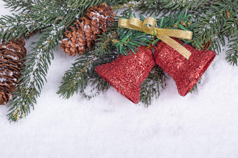 Border of Christmas Bells, Evergreen Branch and Pine Cones. On a snow white background stock image
