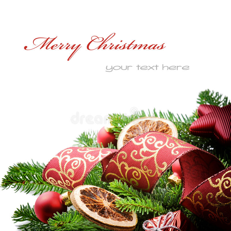 Border with Christmas decorations. Border with Christmas tree branches and festive decorations isolated over white stock photo