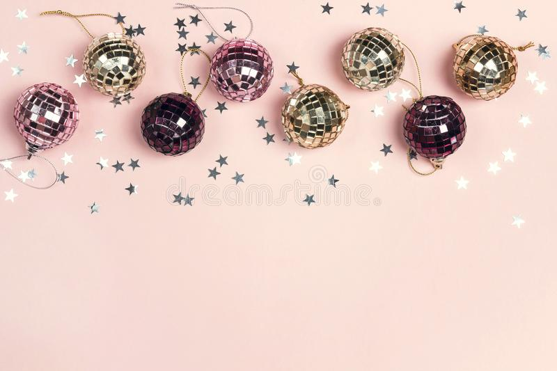 Border of Christmas decorations and copy space on a pink backgr royalty free stock photography