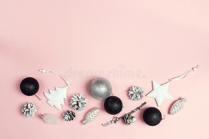 Border of Christmas decorations on a pink background. Compositi stock photos
