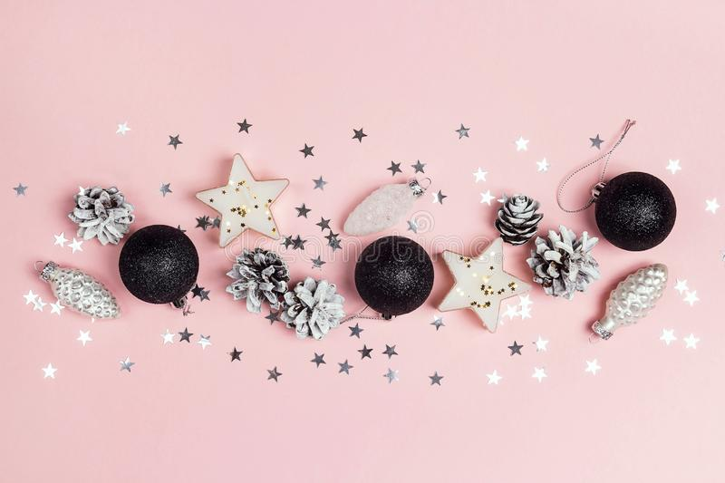 Border of Christmas decorations on a pink background. Compositi royalty free stock images