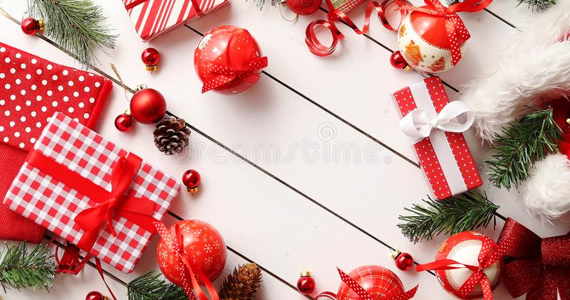 Border from Christmas presents and decorations. From above shot of various cute Christmas decorations and nicely wrapped gifts forming cute border on white royalty free stock photo
