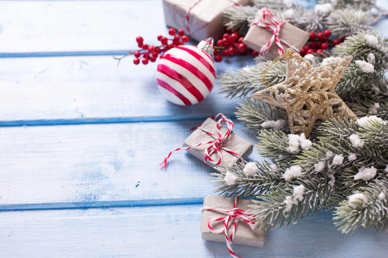 Border from christmas presents, fur tree branches, balls and re stock photo