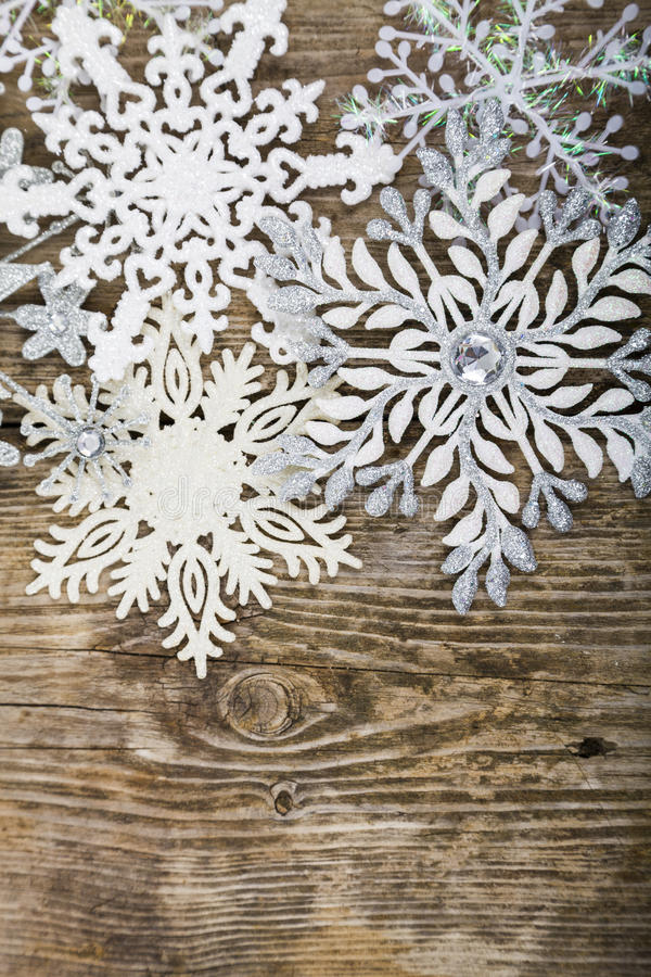 Border of Christmas snowflakes. On old wooden background royalty free stock photo