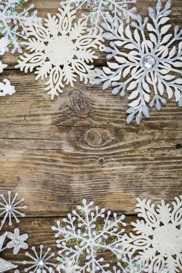 Border of Christmas snowflakes. On old wooden background stock photo