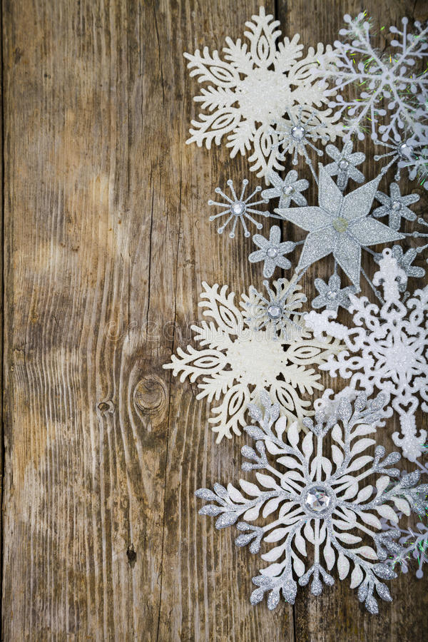 Border of Christmas snowflakes. On old wooden background royalty free stock photography
