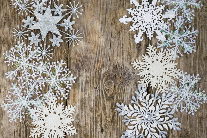 Border of Christmas snowflakes. On old wooden background stock images