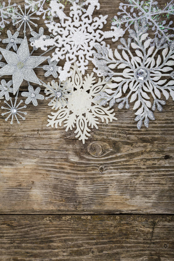Border of Christmas snowflakes. On old wooden background royalty free stock images