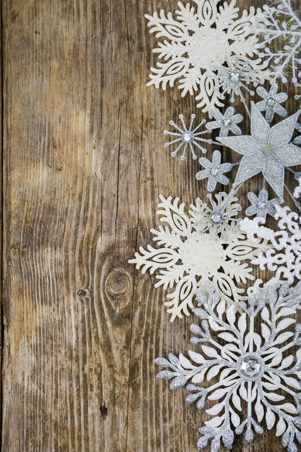 Border of Christmas snowflakes. On old wooden background stock photography