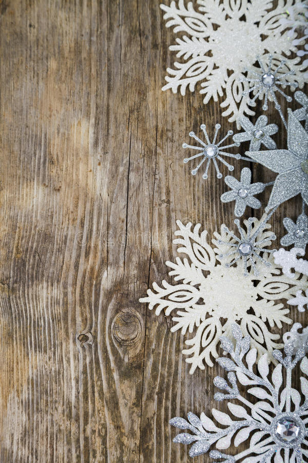 Border of Christmas snowflakes. On old wooden background stock image