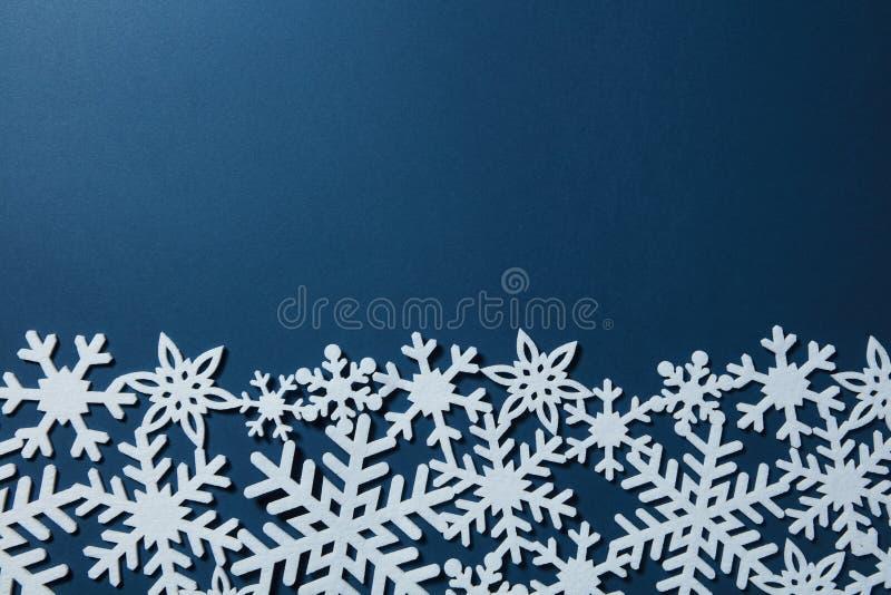 Border of Christmas snowflakes. Border of white snowflakes on a blue background. Christmas card stock photos