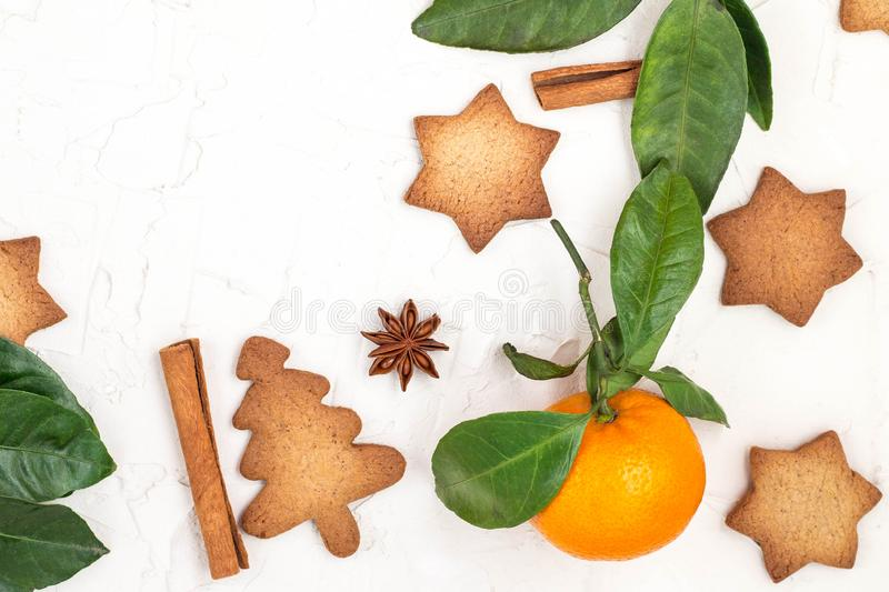 Border of Christmas star cookies with spices and mandarin on white background with copyspace. Top view royalty free stock images