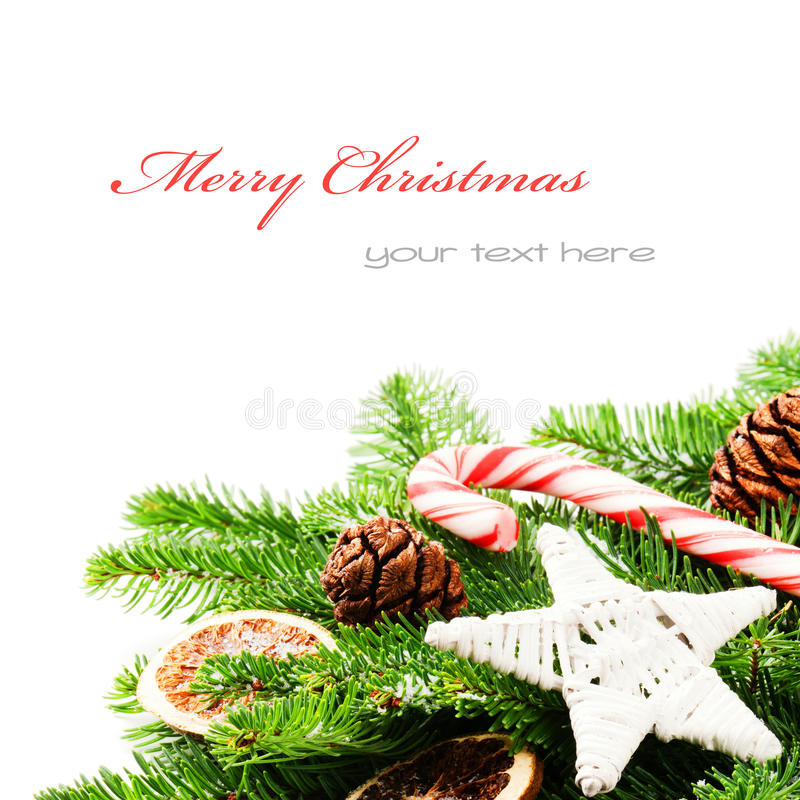 Border with Christmas tree branches. And vintage decorations isolated over white stock photo