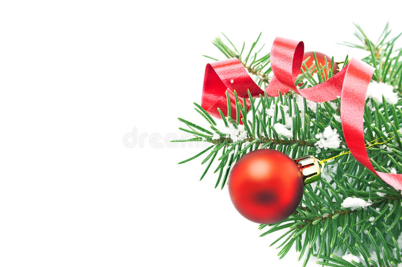 Border of Christmas tree branches with Christmas decoration: red. Baubles, ribbon, pinecone and snowflakes isolated on white. Holiday background. Top view stock photos