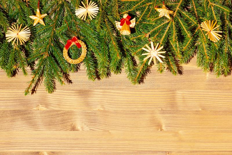 Border with Christmas tree branches and decorations. Copy space for text.  royalty free stock photo