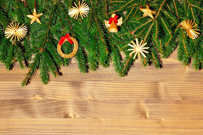 Border with Christmas tree branches and decorations. Copy space for text.  royalty free stock photos