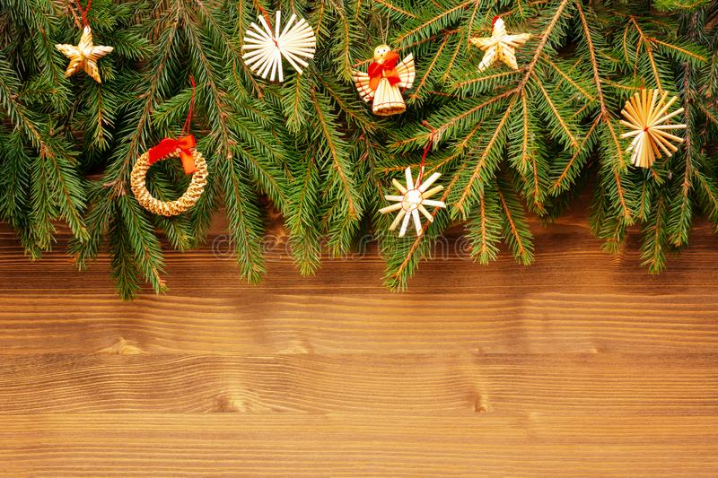 Border with Christmas tree branches and decorations. Copy space for text.  stock photo