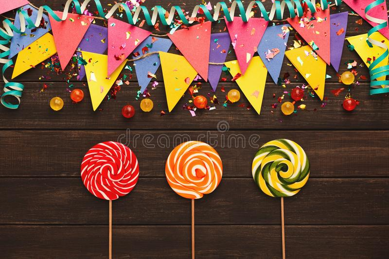 Colorful flags garland on wooden background stock photo
