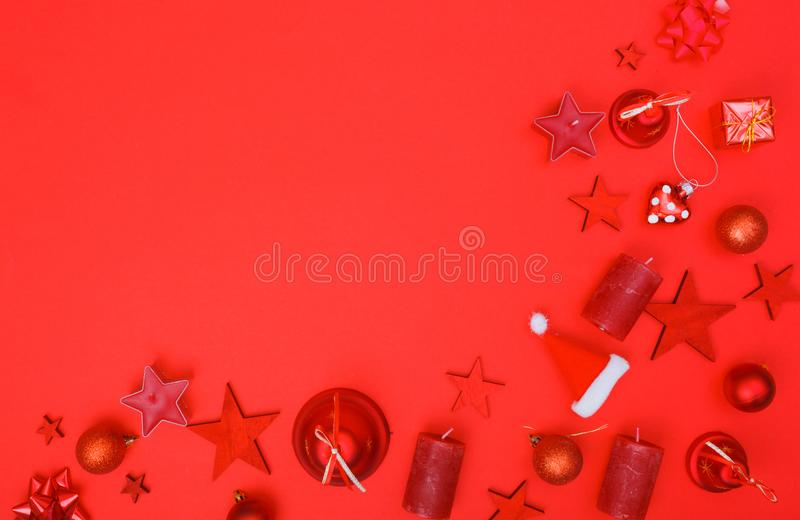 Border corner from red only christmas flat lay decoration. Corner border frame from Christmas flat lay decoration elements with empty light box for copy space in royalty free stock photography