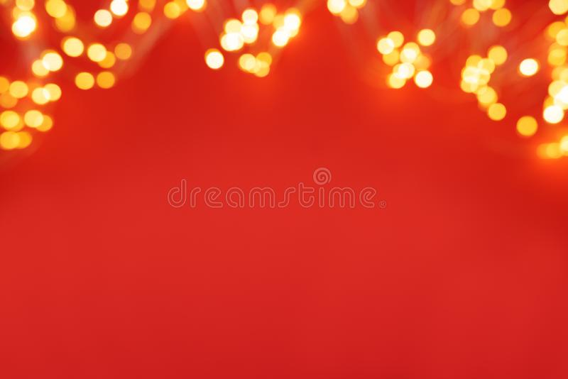 Border of defocused Christmas lights on red background. Christmas and New Year holidays celebration concept stock photos