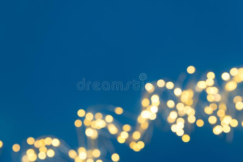 Border of defocused Christmas lights on red background. Christmas and New Year holidays celebration concept royalty free stock photo