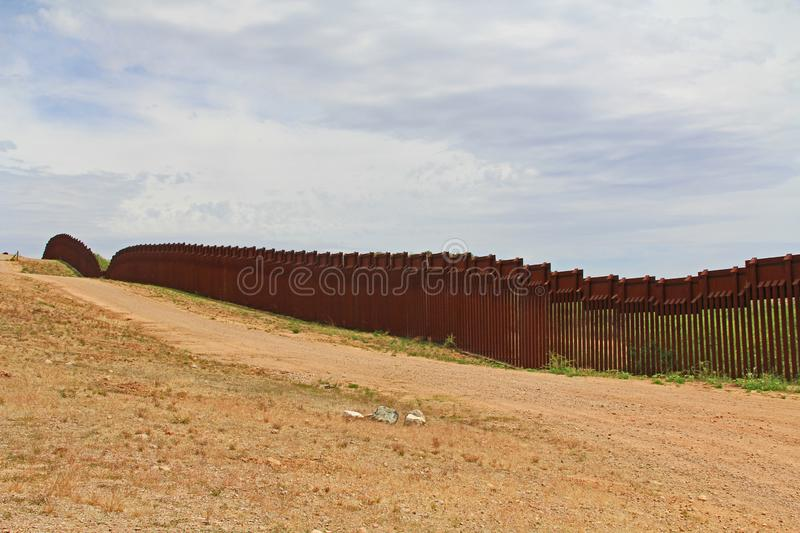Border Fence Separating the US from Mexico Near Nogales, Arizona. Border Fence beside a road near Nogales, Arizona separating the United States from Mexico stock photos