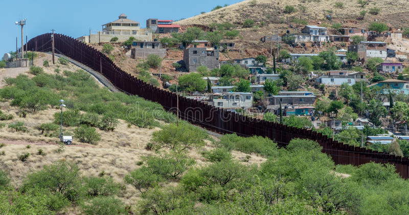 Border fence separating United States and Mexico stock images