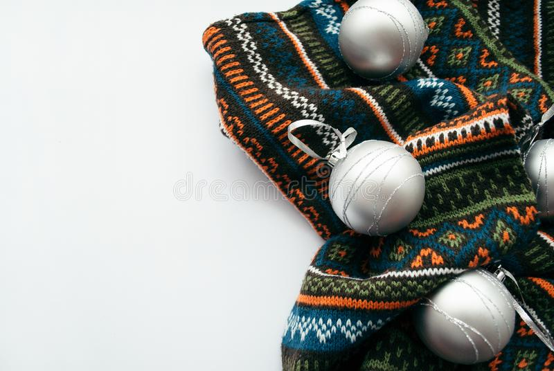 Border frame made of brown scarf and christmas silver balls. Christmas concept on a white background. Border frame made of brown scarf and christmas silver stock images