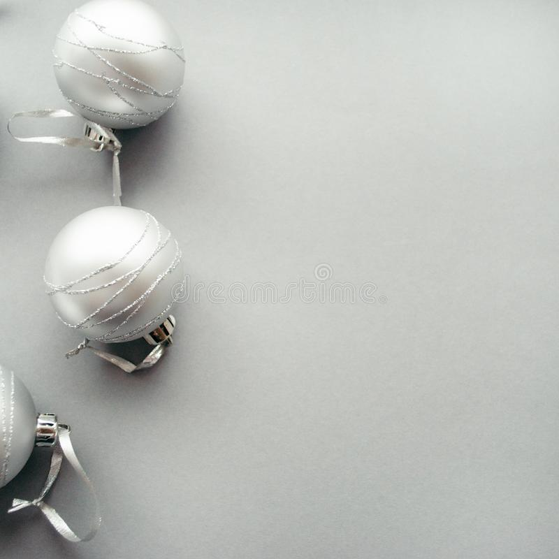 Border frame made of christmas silver balls. Christmas concept on a gray background.  royalty free stock images