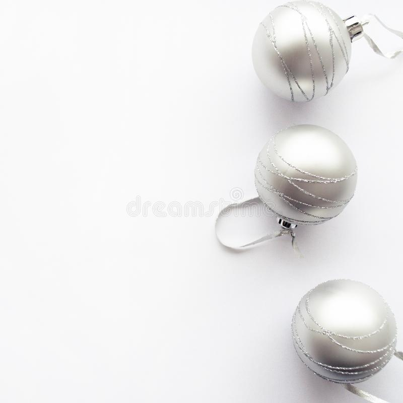 Border frame made of christmas silver balls. Christmas concept on a white background. Border frame made of christmas silver balls. Christmas concept on a white royalty free stock images