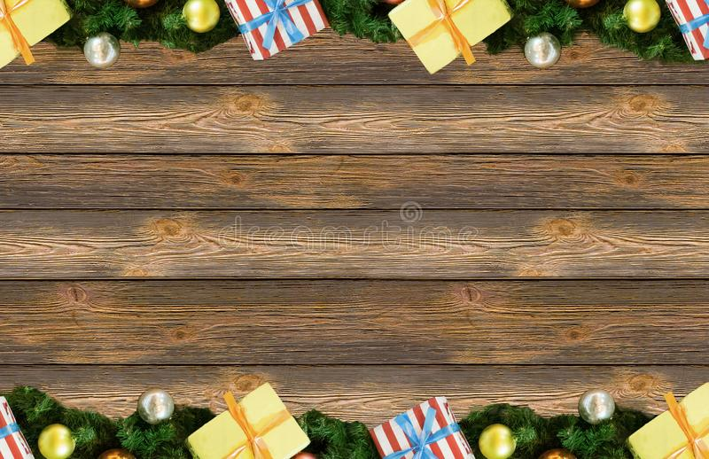 Border frame spruce branch furry christmas. Ball yellow silver and festive boxes base background board with copy space. Christmas New Year Design royalty free stock photos