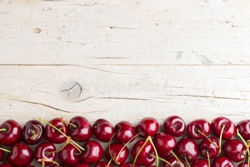 Border of fresh cherries royalty free stock image