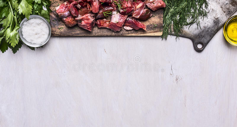 Border with Fresh raw sliced lamb meat cleaver oil salt herbs on white wooden rustic background banner for website space for text. Border with Fresh raw sliced stock photos