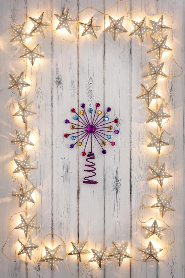 A border of golden star christmas lights, and a purple star, on royalty free stock photos
