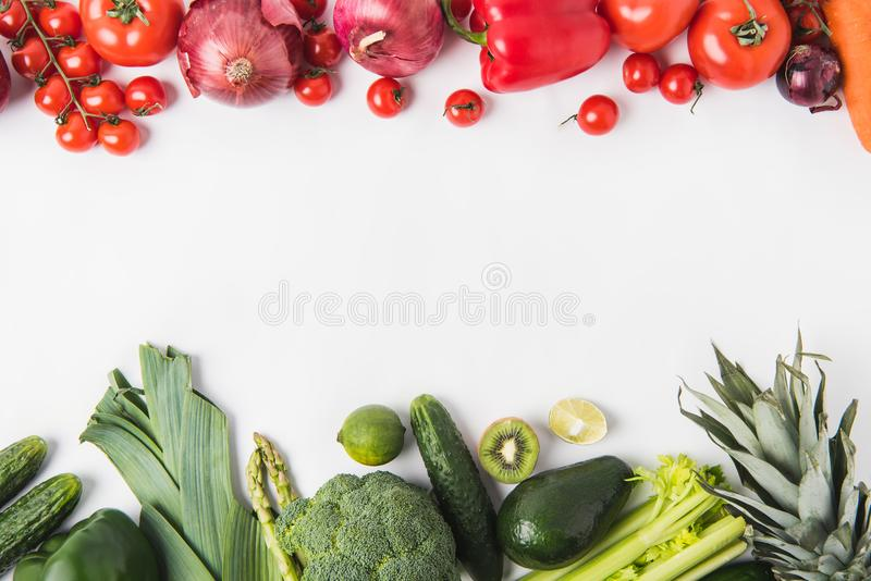 Border of green and red vegetables and fruits isolated on white background royalty free stock photography