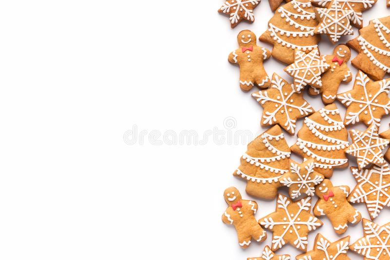 Border of homemade christmas gingerbread cookies on white. Background with copy space for text royalty free stock image