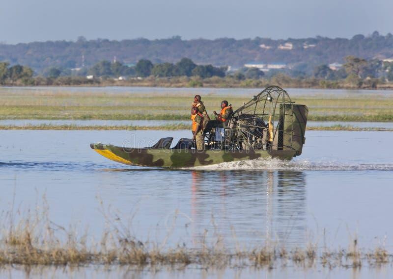 Border Patrol on the Namibia / Botswana border. Members of the BDF (Botswana Defense Force) patrolling the river border between Botswana and Namibia. The Chobe stock images