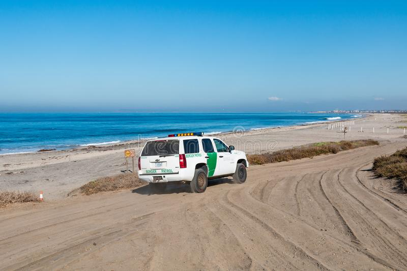 Border Patrol Vehicle Patrolling at Border Field State Park Beach in San Diego royalty free stock photography