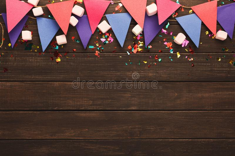 Colorful flags garland on wooden background stock photography