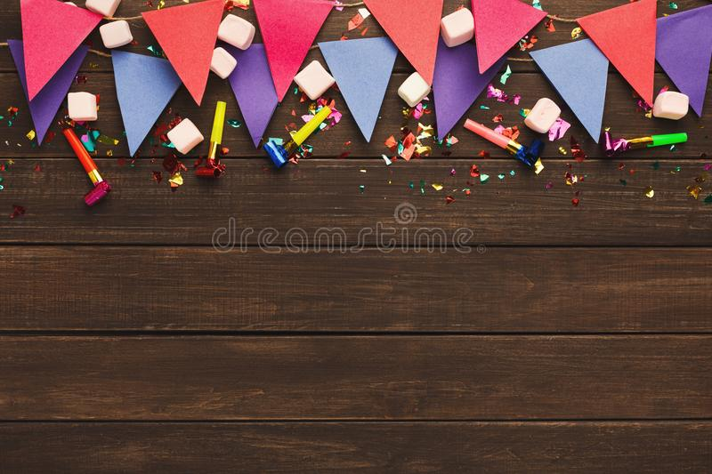 Colorful flags garland on wooden background stock image