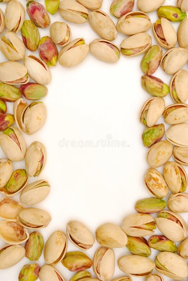 Border of pistachio nuts stock photo